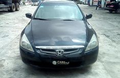 Need to sell high quality black 2003 Honda Accord automatic in Lagos