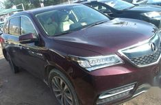 Neatly used brown 2016 Acura MDX automatic in Ikeja