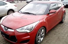 Clean and neat red 2012 Hyundai Veloster hatchback at price ₦1,684,333 in Ibadan