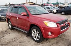 Red 2010 Toyota RAV4 car automatic at attractive price in Lagos