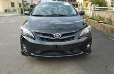 Used black 2011 Toyota Corolla automatic for sale in Lagos