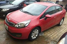 Red 2013 Kia Rio for sale at price ₦1,300,000 in Ikeja