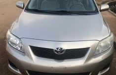 Need to sell cheap used gold 2009 Toyota Corolla automatic