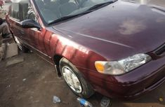 Sell cheap red 2000 Toyota Corolla sedan automatic at mileage 98,333