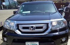 Selling 2011 Honda Pilot suv automatic in Lagos
