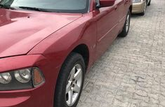 Red 2012 Dodge Charger sedan automatic at mileage 85,321 for sale