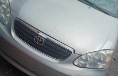 Selling grey 2005 Toyota Corolla sedan automatic