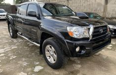Best priced black 2007 Toyota Tacoma at mileage 88,000