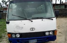 Authentic white 2003 Toyota Coaster manual in good condition