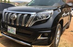 Need to sell cheap used black 2012 Toyota Land Cruiser Prado at mileage 18,879