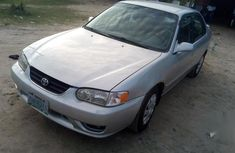 Best priced grey/silver 2002 Toyota Corolla in Warri