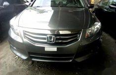 Sell very cheap clean grey/silver 2010 Honda Accord in Lagos