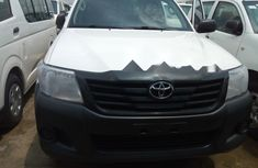 White 2013 Toyota Hilux automatic for sale in Lagos