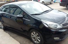 Need to sell high quality black 2014 Kia Rio automatic at price ₦1,950,000