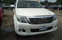 Sell white 2014 Toyota Hilux at mileage 58,005 in Lagos at cheap price
