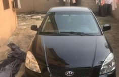 Very sharp neat black 2009 Kia Rio for sale in Ikeja