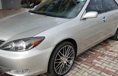 Sell well kept grey/silver 2004 Toyota Camry automatic at mileage 86,000