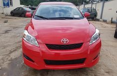 Need to sell cheap used red 2010 Toyota Matrix at mileage 77,611