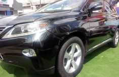 Selling black 2015 Lexus RX automatic in good condition in Ikeja