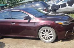 Sell well kept red 2014 Toyota Avalon sedan at price ₦7,200,000