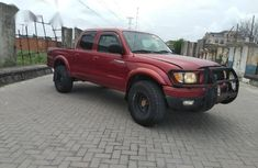 Need to sell red 2004 Toyota Tacoma at price ₦3,400,000