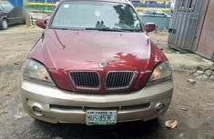 Need to sell red 2005 Kia Sorento at mileage 100,000