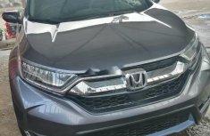 Sell cheap grey/silver 2017 Honda CR-V automatic in Lagos