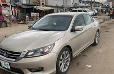 Gold 2013 Honda Accord at mileage 70,000 for sale in Lagos