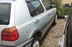 Need to sell cheap used grey/silver 1995 Volkswagen Golf at mileage 180,000