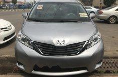 Best priced grey/silver 2012 Toyota Sienna van / minibus automatic in Lagos