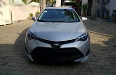 Best priced used grey/silver 2017 Toyota Corolla automatic in Abuja