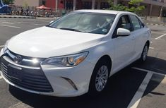 Very sharp neat white 2016 Toyota Camry automatic for sale