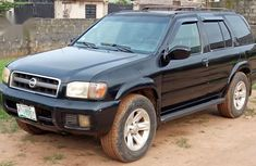 Need to sell high quality black 2002 Nissan Pathfinder automatic at price ₦700,000