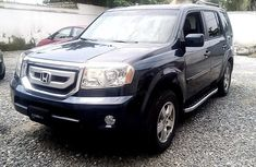 Selling blue 2011 Honda Pilot automatic in good condition in Lagos