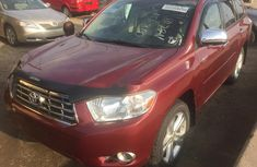 Sell red 2010 Toyota Highlander suv automatic in Lagos