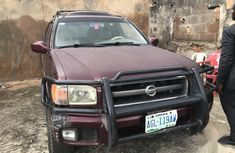 Sell red 2002 Nissan Pathfinder automatic in Ikeja at cheap price