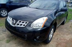 Sell well kept 2013 Nissan Rogue at mileage 1