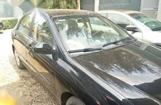 Clean and neat black 2007 Kia Cerato for sale