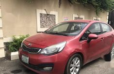 Selling red 2012 Kia Rio manual