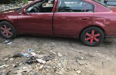 Clean and neat used red 2006 Nissan Altima automatic in Lagos at cheap price
