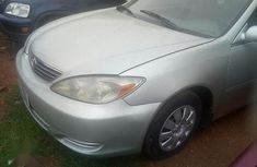 Need to sell cheap used white 2005 Toyota Camry at mileage 114,215
