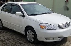 Need to sell cheap used white 2003 Toyota Corolla automatic in Sokoto