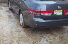 Selling blue 2003 Honda Accord automatic in good condition in Lagos