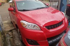 Sell well kept red 2010 Toyota Matrix automatic at price ₦3,200,000