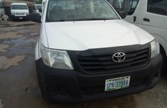 Sell very cheap clean white 2013 Toyota Hilux in Lagos