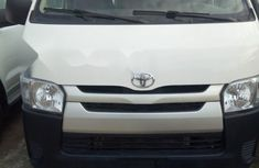 Selling white 2012 Toyota HiAce van in good condition