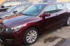 Need to sell cheap used red 2014 Honda Accord automatic in Lagos