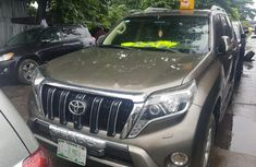 Sell well kept gold 2014 Toyota Land Cruiser Prado automatic at price ₦9,500,000