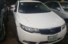 Need to sell high quality white 2011 Kia Cerato automatic in Lagos
