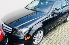 Neatly used blue 2013 Mercedes-Benz C300 automatic in Lagos